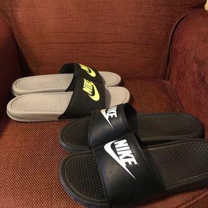 2 pairs of Nike Slides